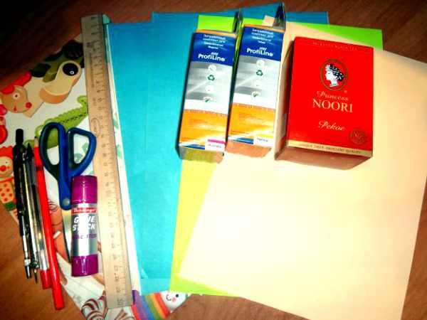 Цветная бумага, картонные коробочки, ножницы, линейка и другие инструменты